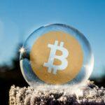Moeda Bitcoin dentro de uma bolha