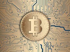 moeda dourada com o símbolo do bitcoin