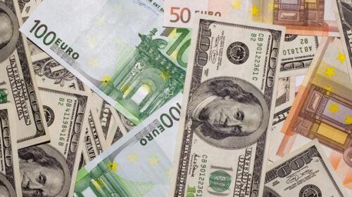 várias notas de euro e dólar