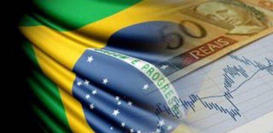Montagem de bandeira do Brasil, nota de cinquenta reais e gráfico