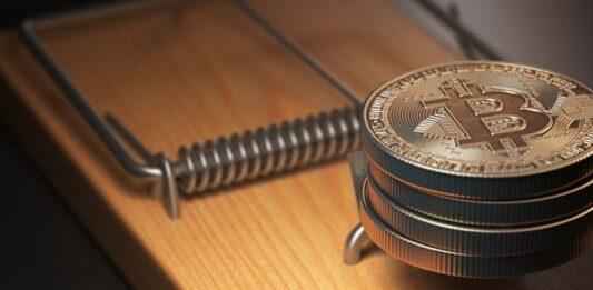 Criptomoedas Bitcoin em uma ratoeira gigante