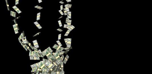várias notas de dólares caindo