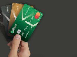 Mão segurando 4 tipos de Cartões de crédito do Banco Original