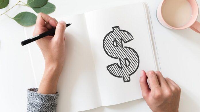 caderno de um investidor desenhando o cifrão
