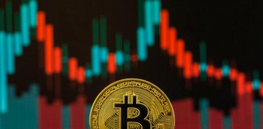 Criptomoeda Bitcoin com gráficos ao fundo
