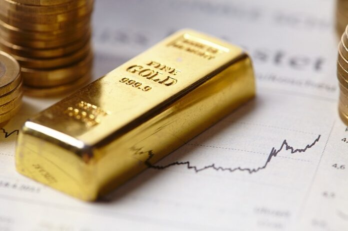 barra de ouro em cima de um gráfico