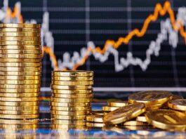gráfico de investimentos com moedas em fileiras e espalhadas
