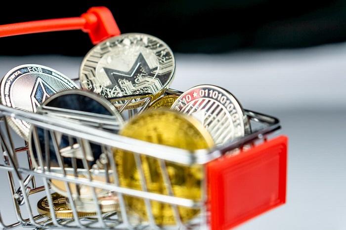 criptomoedas dentro de um carrinho de compras