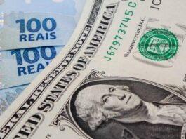 Nota de 1 Dólar e algumas de 100 reais