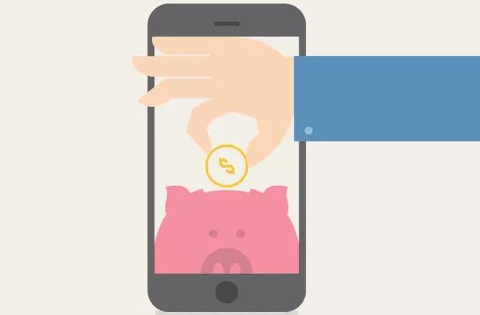 celular com mão colocando dinheiro em porquinho
