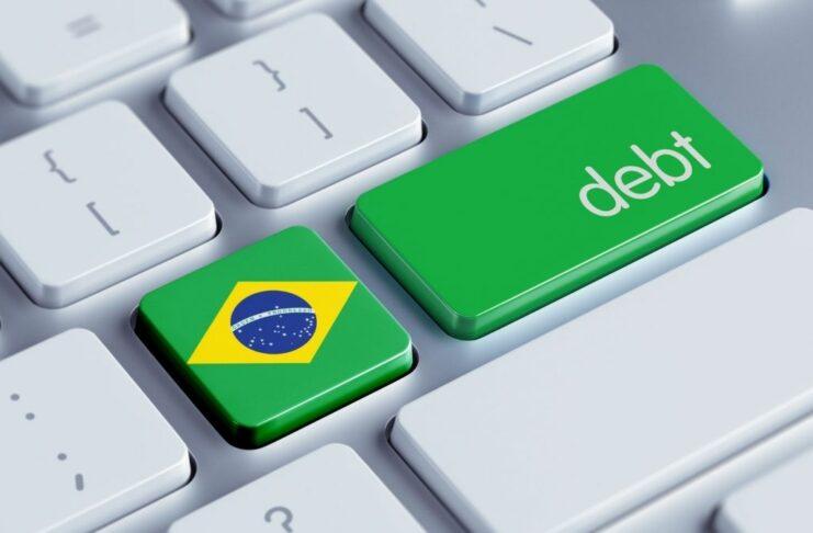 Botão com a bandeira do Brasil sinaliza dívida pública