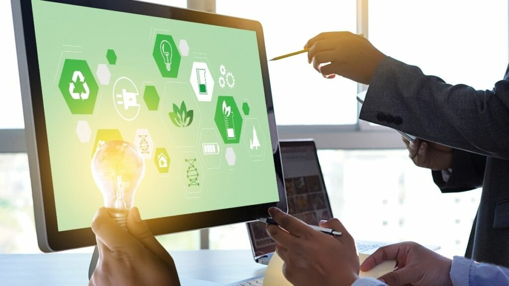 Tela de computador apresenta símbolos de sustentabilidade e investimentos