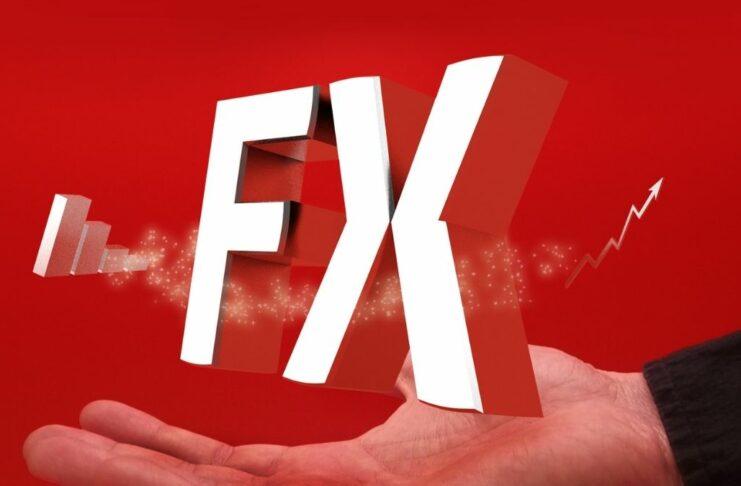 """Ilustração mostra as letras """"F"""" e """"X"""", do termo Forex, flutuando sobre uma mão"""