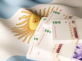 bandeira da Argentina com notas de peso por cima